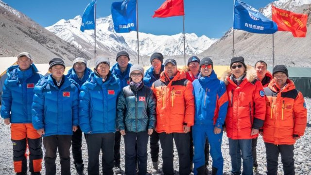 Members of Chinese surveying team pose for photos at Everest Base Camp on May 10, 2020 in Shigatse, Tibet Autonomous Region of China.