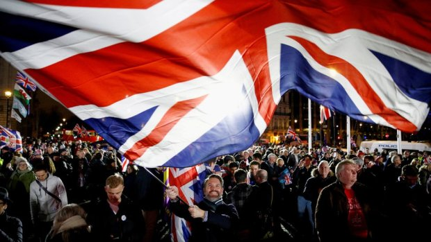 A man waves a UK flag on Brexit day in London, Britain, 31 January 2020.