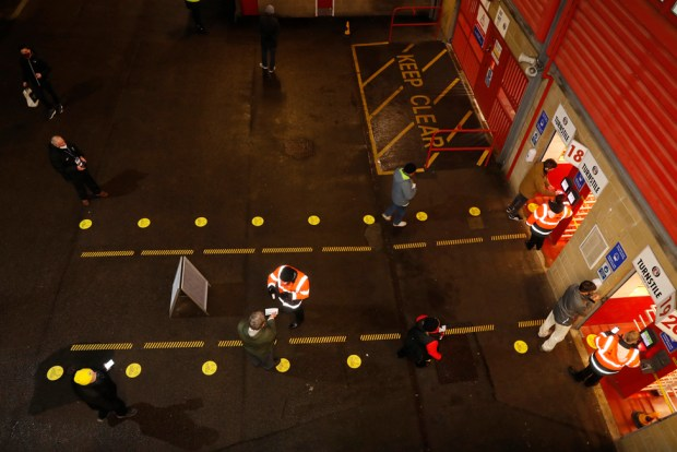 Aerial view of fans being checked by stewards outside the stadium in Charlton, London