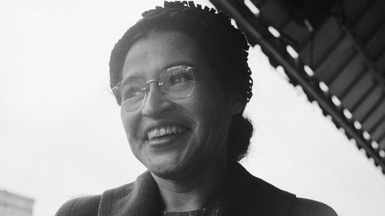 Rosa Parks photographed smiling after the Supreme Court ruled bus segregation to be unconstitutional