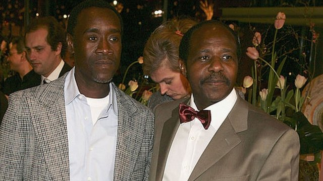 """Actor Don Cheadle (L) and Paul Rusesabagina arrive at the """"Hotel Rwanda"""" Premiere during the 55th annual Berlinale International Film Festival on February 11, 2005 in Berlin, Germany."""