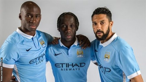 Eliaquim Mangala, Bacary Sagna and Gael Clichy model Manchester City's new home kit