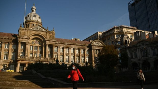 A woman walks past Birmingham's town hall