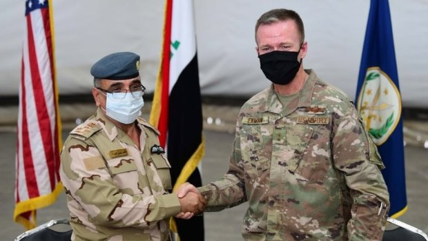 Gen Salah Abdullah (L) shakes hands with Gen Kenneth Ekman, the deputy commander of Combined Joint Task Force-Operation Inherent Resolve, during a handover ceremony at Taji airbase, Iraq (23 August 2020)