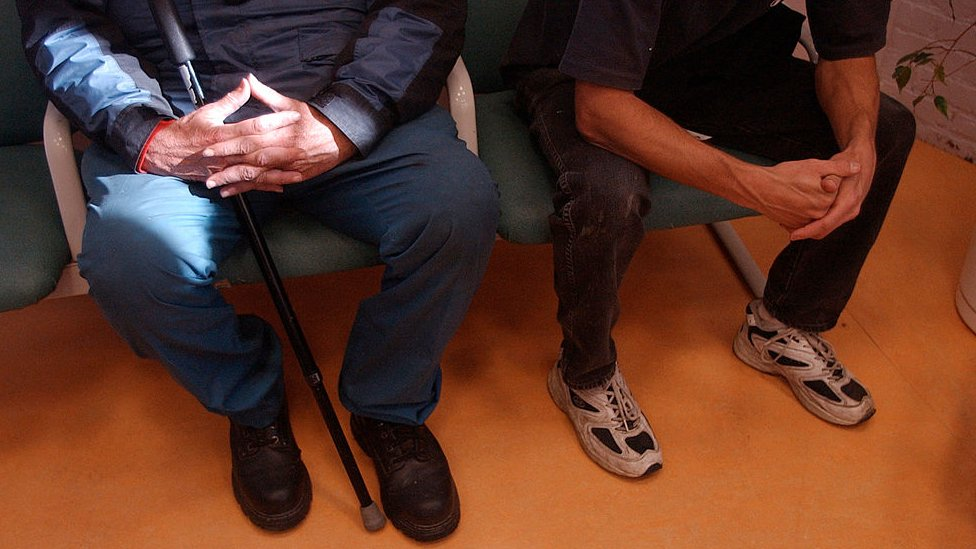 Patients wait in the waiting room to see physician