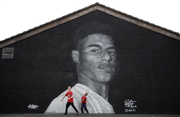 A mural of Manchester United striker Marcus Rashford by Street artist Akse on the wall of the Coffee House Cafe on Copson Street, Withington. 8 November 2020.