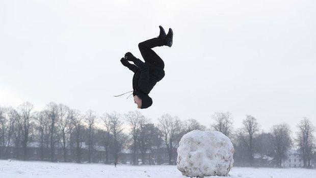 A boy does a backflip