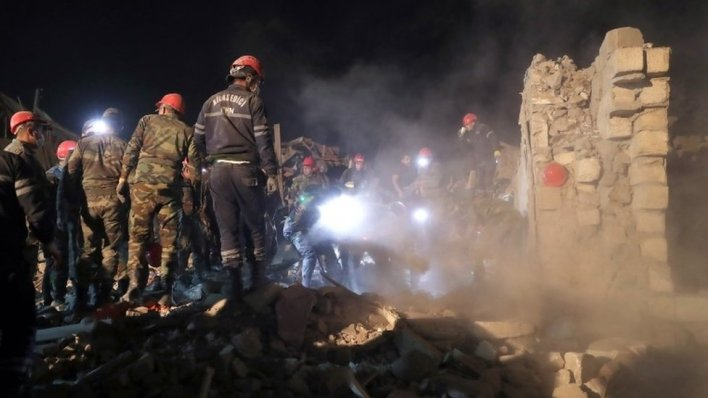 Rescue workers at the scene of damage in the Azerbaijani city of Ganja