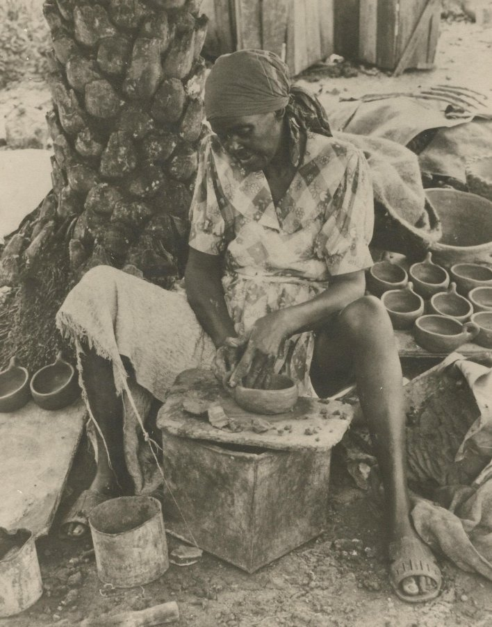 Historical photo from the National Museum of Antigua and Barbuda of a woman making traditional pottery