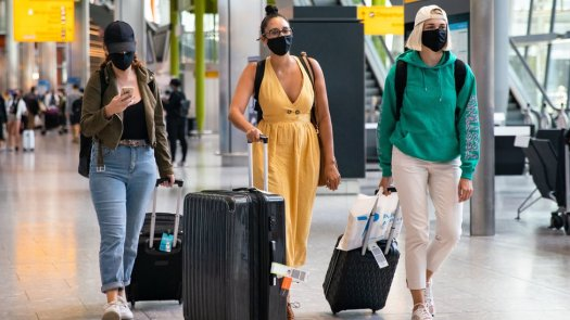 Travellers arriving at London Heathrow Airport