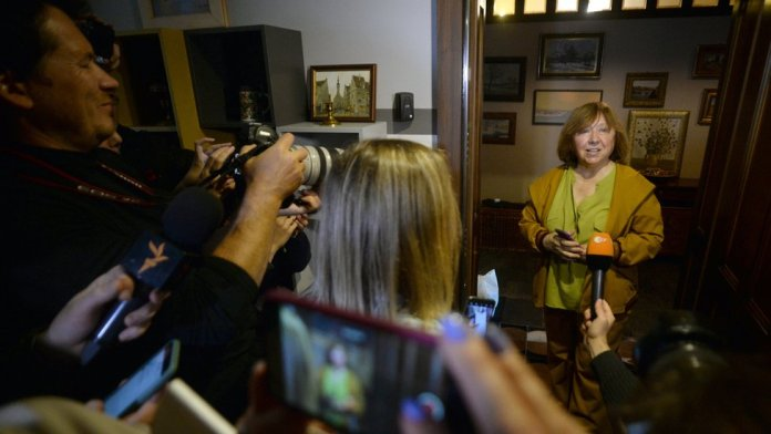 Svetlana Alexievich called supporters to her home, saying masked men had tried to enter it