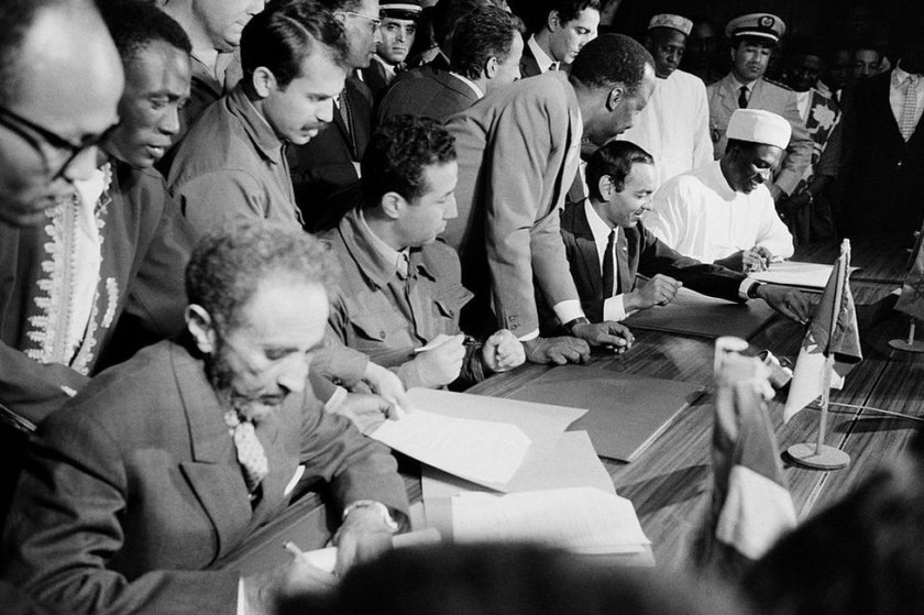 Haile Selassie signing a document