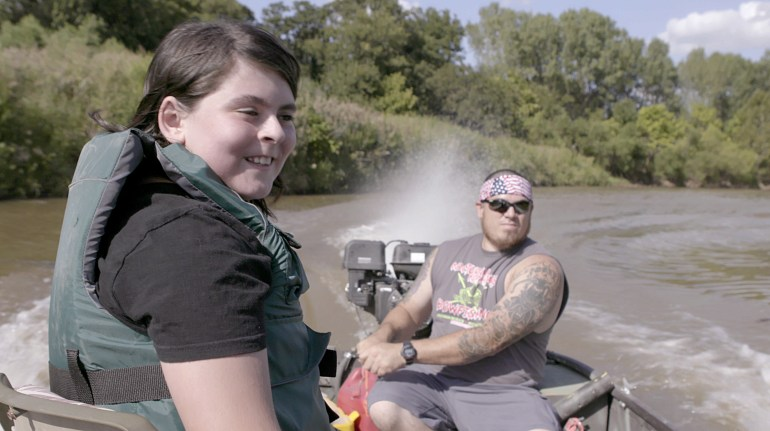 Matthew on a fishing trip with his father, Juan