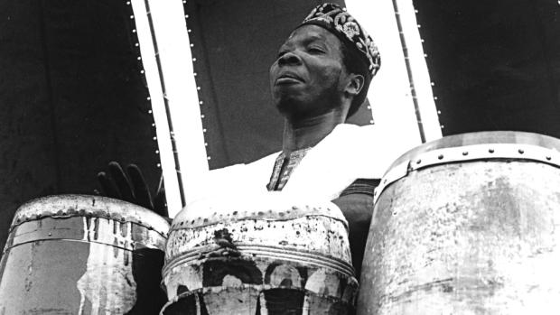 Babatunde Olatunji playing drums - circa 1960