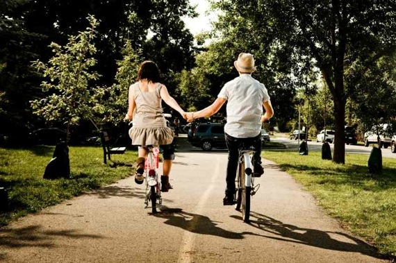 A Couple, Riding Bikes and Hoding Hands Photo courtesy of ©iStockphoto.com/Renphoto, Image #10291317