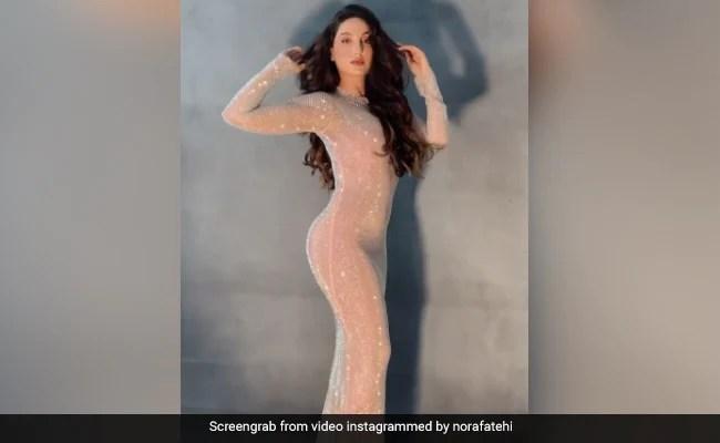 नोरा फतेही ने बॉडीकॉन ड्रेस में कराया स्टाइलिश फोटोशूट, देखें वायरल Video