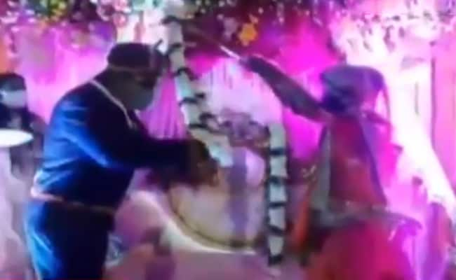 Watch: Bride, Groom Exchange Garlands, Social Distancing-Style