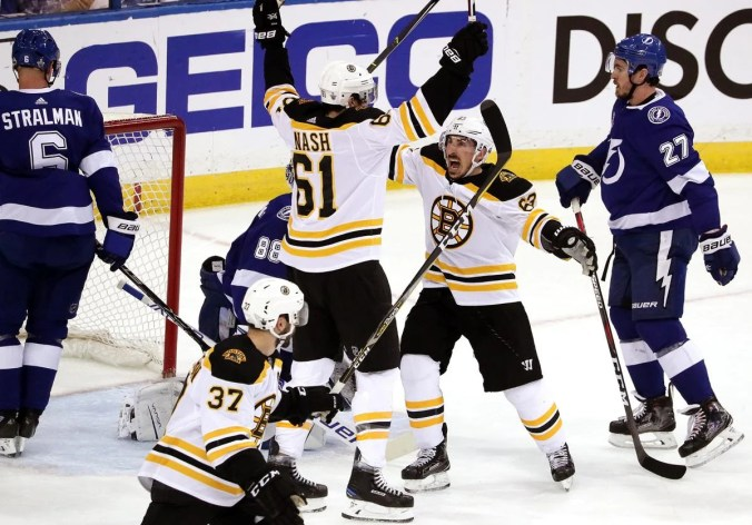 Rick Nash (61) is met by Brad Marchand after connecting on a power-play goal in the first period.