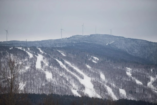 Windmills line a ridge above old Balsams ski trails.