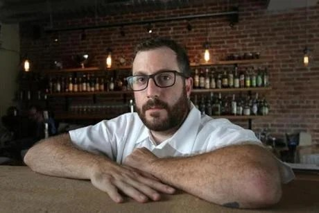 Chef-owner David Punch in his Newton restaurant Sycamore.