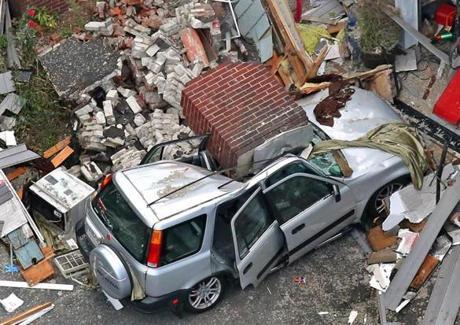LAWRENCE, MA - 9/14/2018: Aftermath Scenes of Lawrence Gas Exposition: The vehicle crushed by brick chimney where one died, two were seen here on Chickering Road in Lawrence. (David L. Ryan / Globe staff) METRO THEME 15Lawrencepic