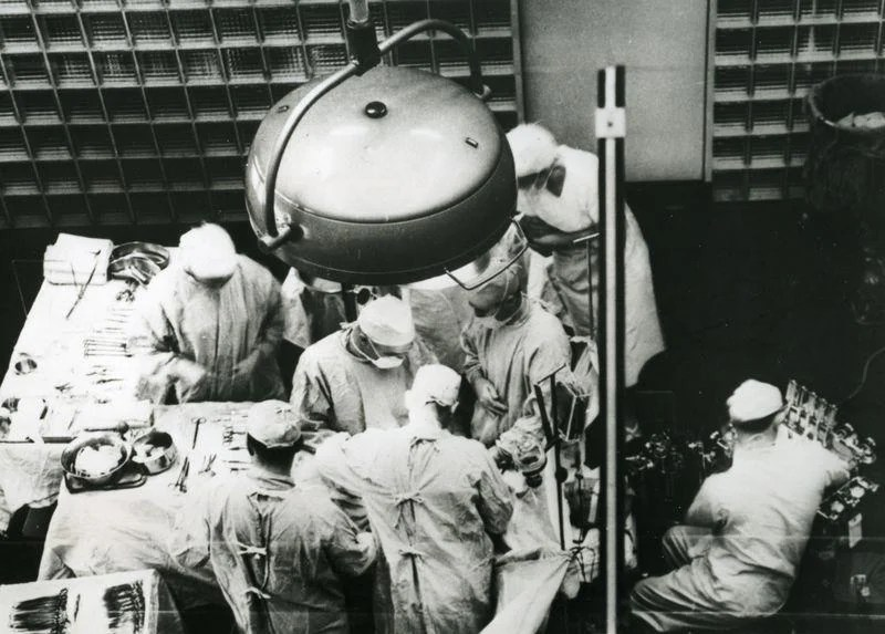 Dr. Joseph E. Murray, at center facing camera, is seen performing the first successful organ transplant on Dec. 23, 1954, at Peter Bent Brigham Hospital in Boston.