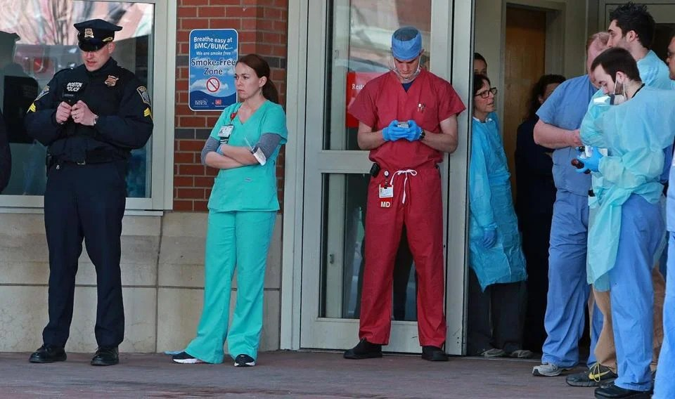 Boston Medical Center personnel waited outside the emergency room for more Marathon bombing victims to arrive.