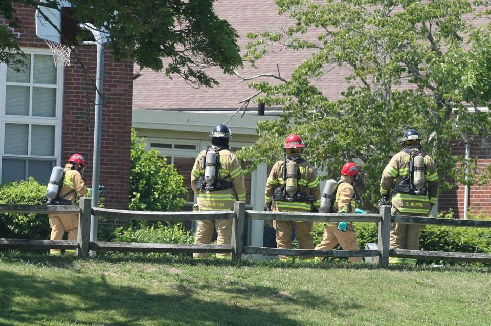 Emergency workers and others stood near Manomet Elementary School Monday afternoon.