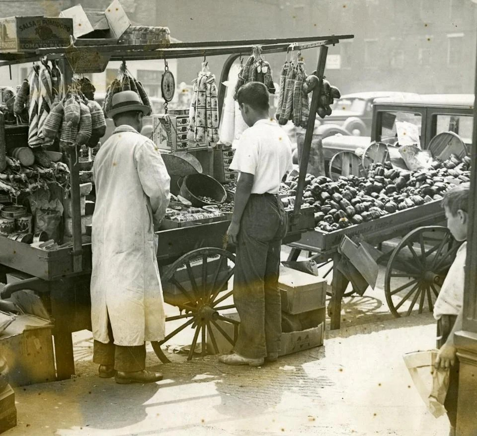 1936 / fromthearchive / Globe Archive photo / North End pushcart vendors could sell you ten different varieties of bologna, as well as a wide selection of cheeses and vegetables.<br /><br />