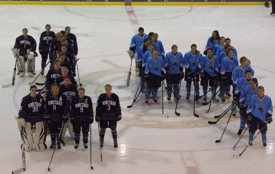 Players from Sandwich and Martha's Vineyard formed a No. 14 to honor injured Boston Pride forward Denna Laing.