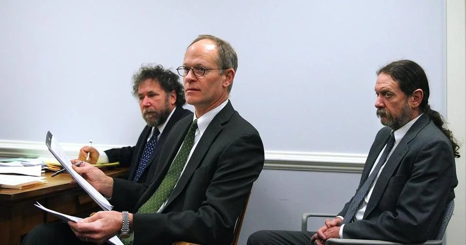 Bill Downing (right) appeared in court in Brighton with his attorneys Steven S. Epstein, left, and John G. Swomley.