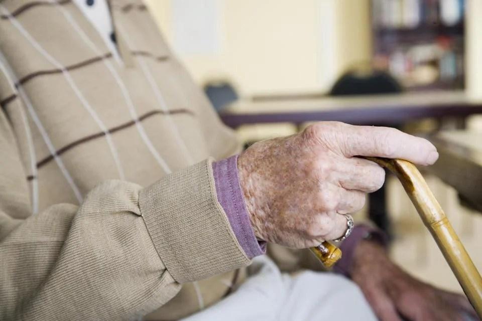 An elderly man holding a walking stick; Shutterstock ID 404718508; PO: oped
