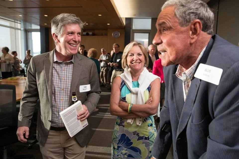 """Tom Bergeron (left) with Emily Rooney and Bob Lobel at a party at WGBH celebrating the new book """"The Golden Age of Boston Television."""""""