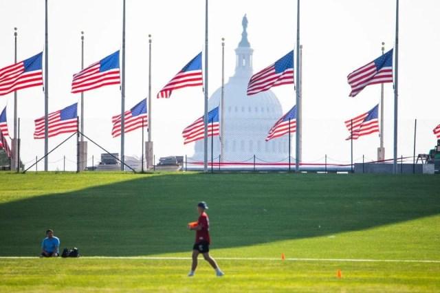 Flags around the Washington Monument were flown at half-mast on Sunday to mark the death of Senator John McCain.