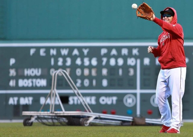 Brock Holt had his sweatshirt on as he played some catch before batting practice.