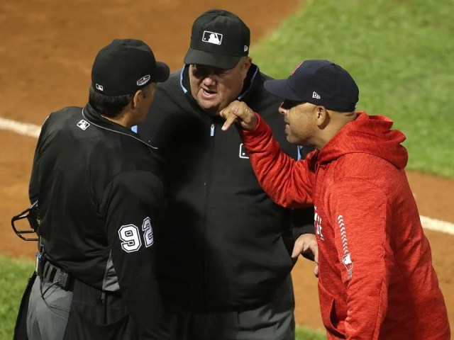 Boston, MA 10/13/18: Red Sox manager Alex Cora argues with the umpires at the end of fifth inning. Boston Red Sox hosted the Houston Astros in Game One of ALCS at Fenway Park Saturday, Oct. 13, 2018. (