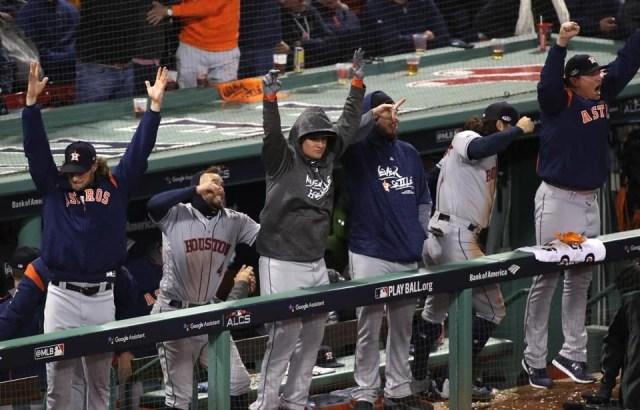 The Astros dugout reacts to Yuli Gurriel's three-run home run.