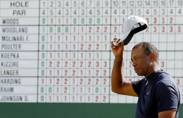 AUGUSTA, GEORGIA - APRIL 11: Tiger Woods of the United States waves on the 18th green during the first round of the Masters at Augusta National Golf Club on April 11, 2019 in Augusta, Georgia. (Photo by Kevin C. Cox/Getty Images)