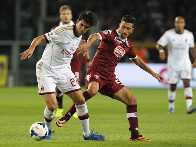 AC Milan's Kaka fends off a Torino player on September 14, 2013