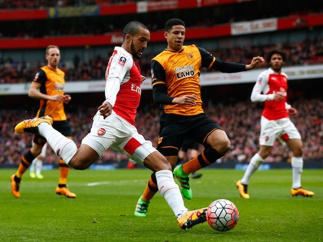 Theo Walcott and Curtis Davies in action during the FA Cup game between Arsenal and Hull City on February 20, 2016