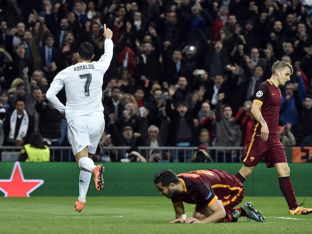 Cristiano Ronaldo scores during the Champions League game between Real Madrid and Roma on March 8, 2016
