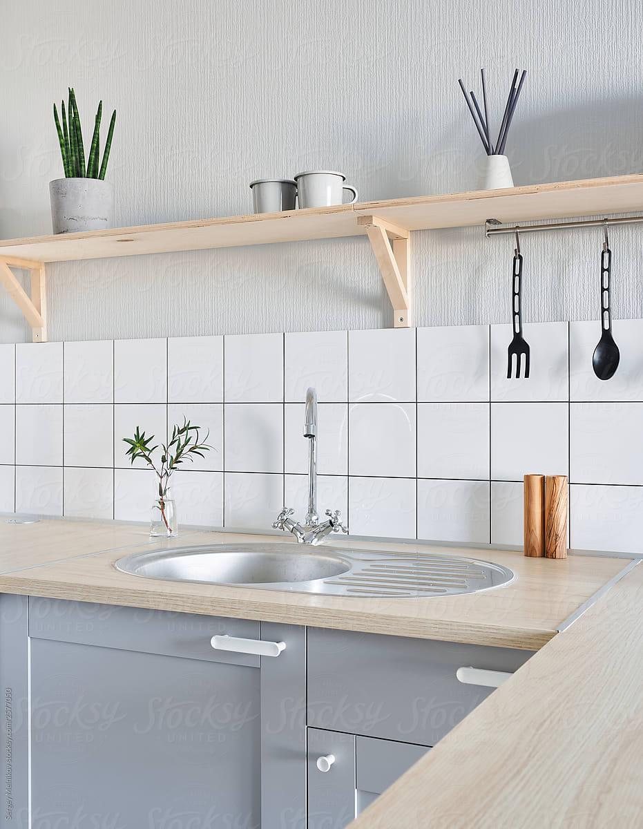 shelf over sink in kitchen by sergey melnikov for stocksy united