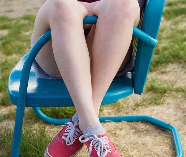 Teen Hangs Crossed Legs Over Metal Chair By Tana Teel For Stocksy United
