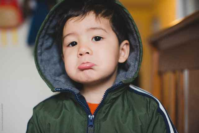 Little kid making sad face by Lauren Naefe - Stocksy United