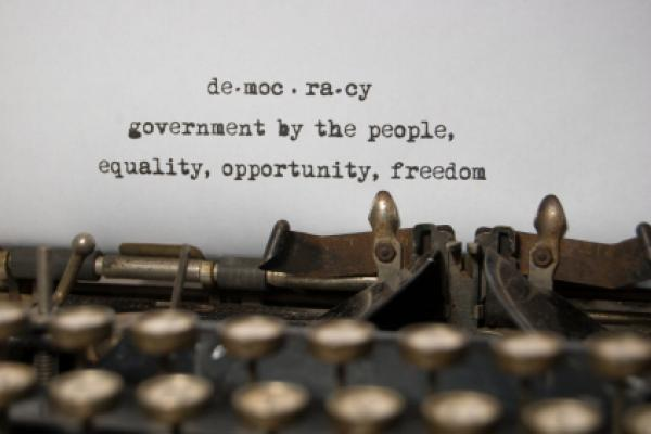 Definition of democracy typed on a typewriter.