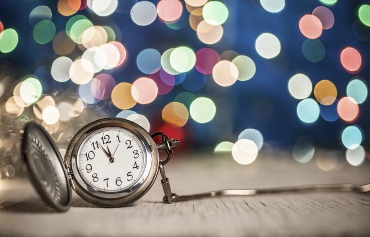 Leap Second 2016 to Be Added New Year s Eve Stop Watch clock at midnight multi colored lights in the background