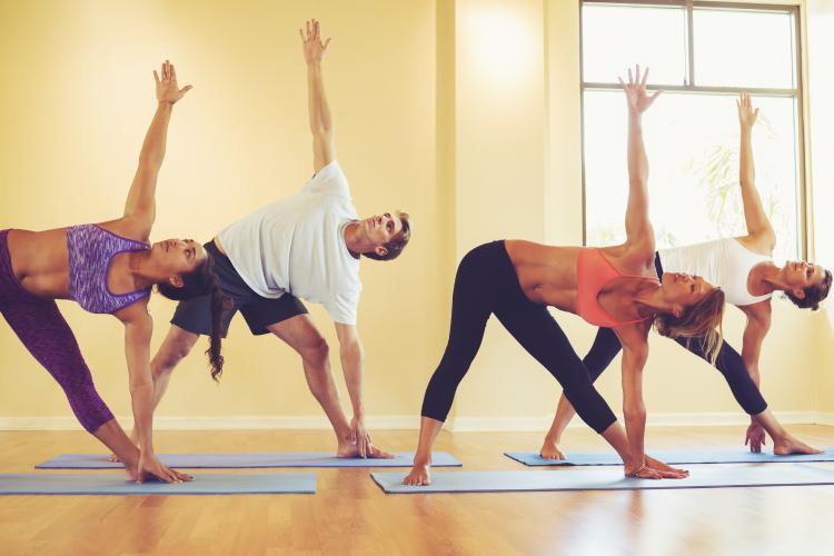 Group of people doing yoga.