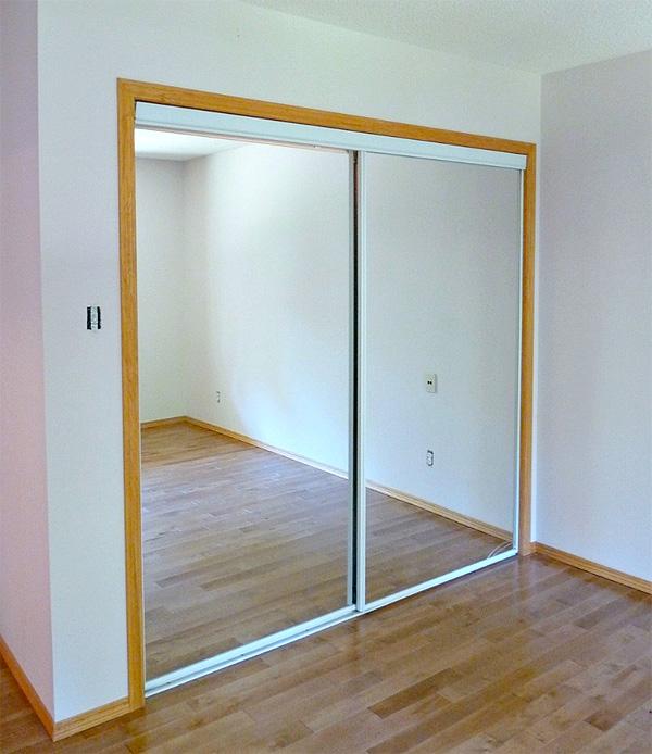 Old closet doors in a bedroom