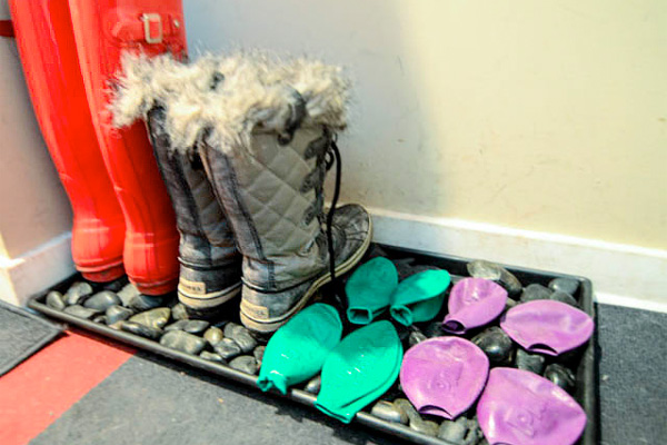 River rocks in a boot tray for wet winter boots