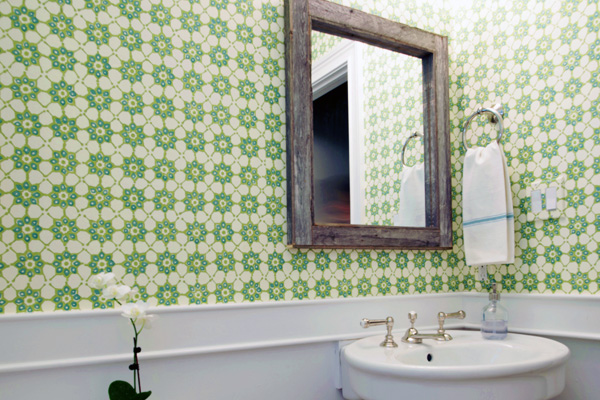 Powder room in Pennsylvania with patterned wallpaper